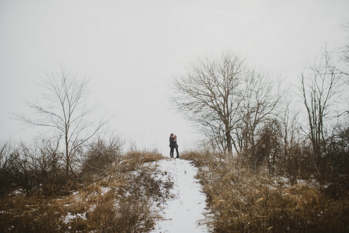 The Colagrossis, Winter Engagement Session, Midwest wedding photographer, midwest engagement session, winter engagement, snow storm wedding, hay bale engagement session